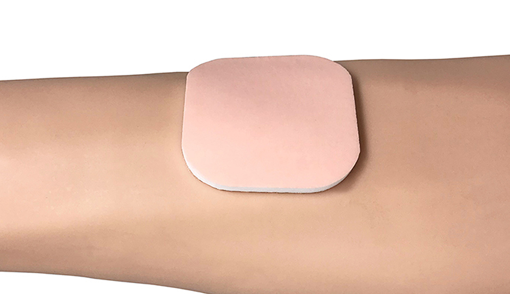 C-Foam Silicone dressing placed on patient's arm.