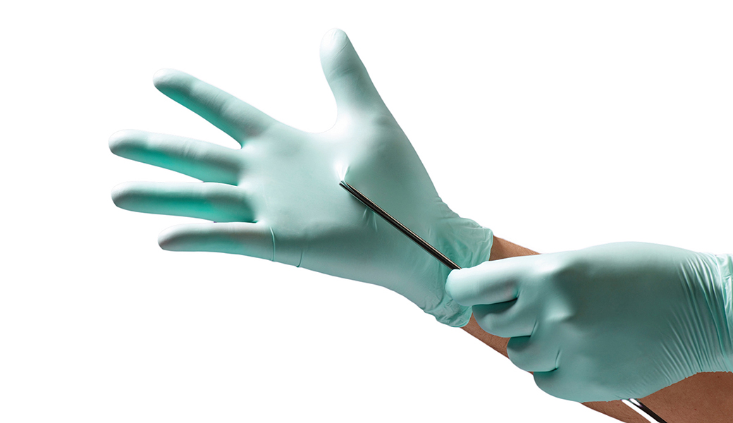 NHS staff holding medical equipment with Vitrex latex-free medical gloves.